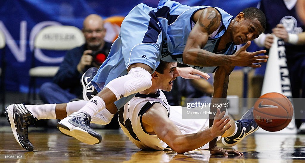 Xavier Munford #5 of the Rhode Island Rams and Andrew Smith #44 of the Butler Bulldogs battle for a loose ball at Hinkle Fieldhouse on February 2, 2013 in Indianapolis, Indiana.
