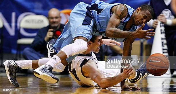 Xavier Munford of the Rhode Island Rams and Andrew Smith of the Butler Bulldogs battle for a loose ball at Hinkle Fieldhouse on February 2 2013 in...