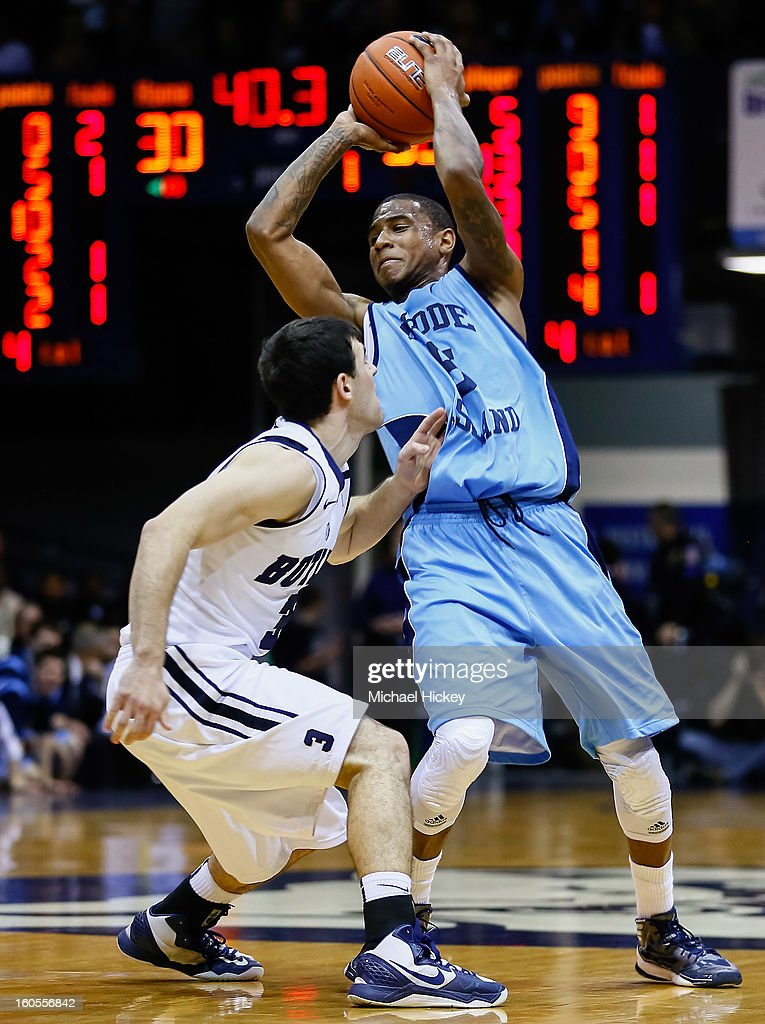 Xavier Munford #5 of the Rhode Island Rams tries to hold off Alex Barlow #3 of the Butler Bulldogs at Hinkle Fieldhouse on February 2, 2013 in Indianapolis, Indiana. Butler defeated Rhode Island 75-68.