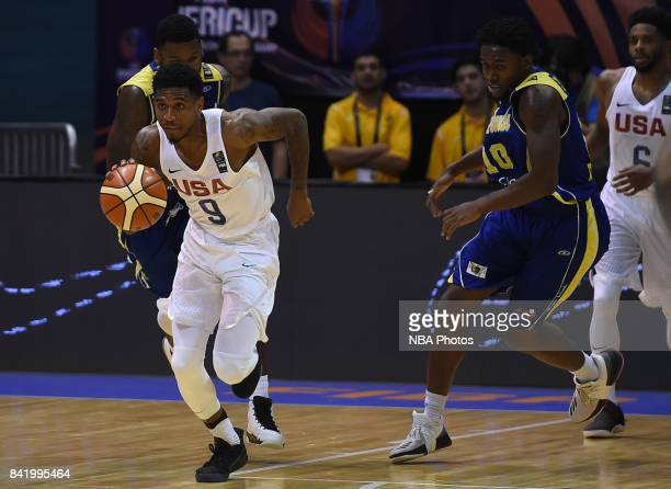 Xavier Munford of United States dribbles the ball around Jahmia Simmons of Virgin Islands during the FIBA Americup semi final match between US and...