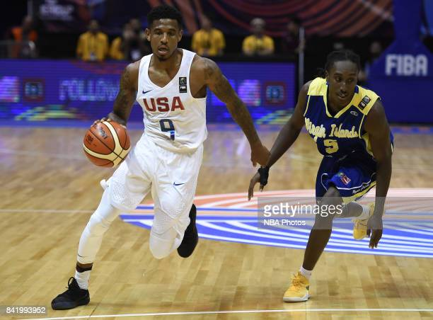 Xavier Munford of United States dribbles the ball past Stephaun Adams of Virgin Islands during the FIBA Americup semi final match between US and...
