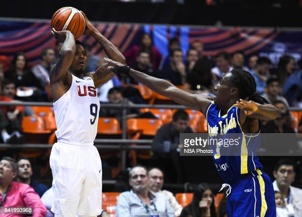 Xavier Munford of United States shoots over Stephaun Adams of Virgin Islands during the FIBA Americup semi final match between US and Virgin Islands...