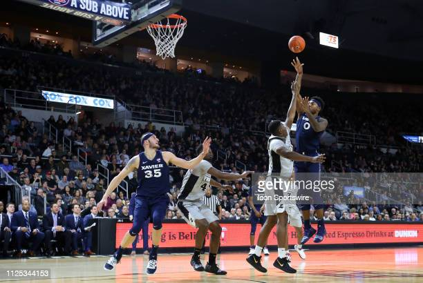 Xavier Musketeers forward Tyrique Jones shoots over Providence Friars forward Kalif Young during a college basketball game between Xavier Musketeers...