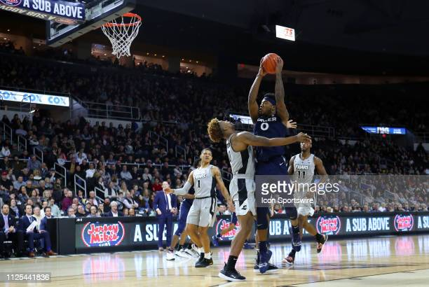 Xavier Musketeers forward Tyrique Jones shoots over Providence Friars center Nate Watson during a college basketball game between Xavier Musketeers...