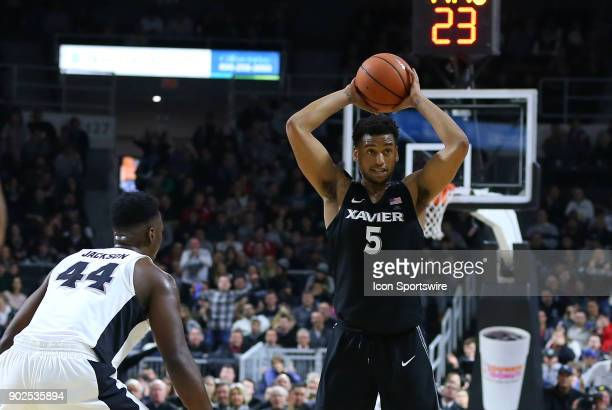 Xavier Musketeers guard Trevon Bluiett defended by Providence Friars guard Isaiah Jackson during a college basketball game between Xavier Musketeers...