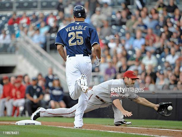 Xavier Nady of the Arizona Diamondbacks reaches out for the throw as he gets the out on Will Venable of the San Diego Padres at first base during the...