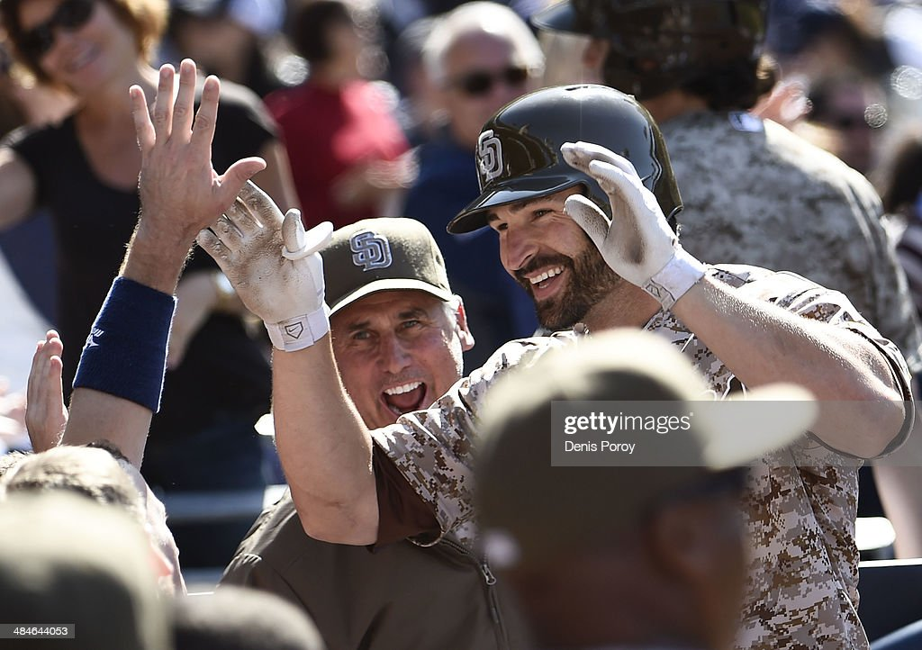 Xavier Nady #21 of the San Diego Padres is congratulated after hitting a solo home run during the seventh inning of an inter-league baseball game at Petco Park against the Detroit Tigers April 13, 2014 in San Diego, California.