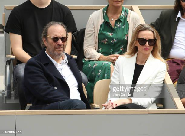 Xavier Niel and Delphine Arnault attend the men's final during day 15 of the 2019 French Open at Roland Garros stadium on June 9 2019 in Paris France