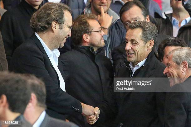 Xavier Niel and Nicolas Sarkozy are seen during the Paris Saint Germain FC vs AS Monaco FC at Parc des Princes on September 22 2013 in Paris France
