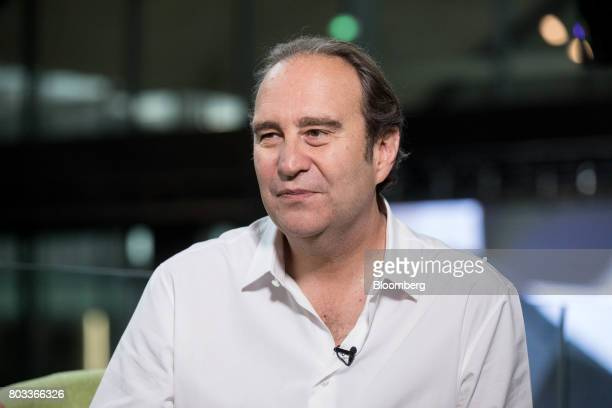 Xavier Niel billionaire and cochief operating officer of Iliad SA speaks during a Bloomberg Television interview in Paris France on Thursday June 29...