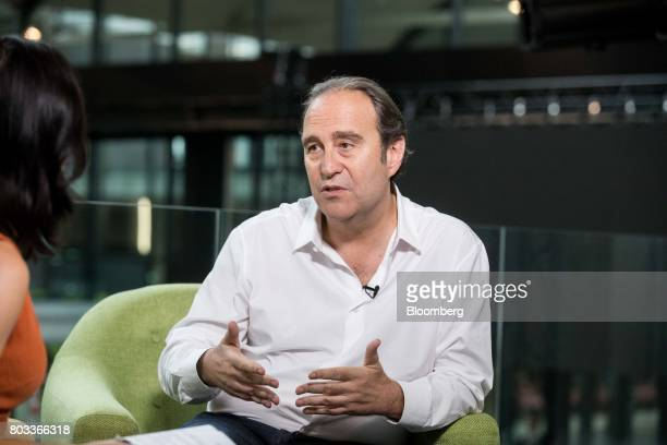 Xavier Niel billionaire and cochief operating officer of Iliad SA gestures as he speaks during a Bloomberg Television interview in Paris France on...