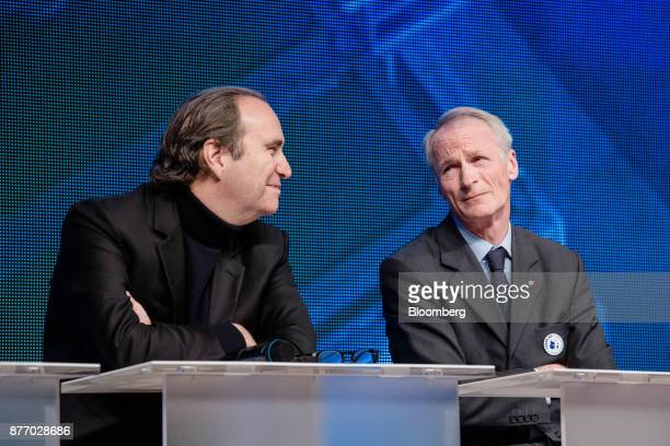 Xavier Niel billionaire and deputy chairman of Iliad SA left sits beside JeanDominique Senard chief executive officer of Michelin Cie during a panel...
