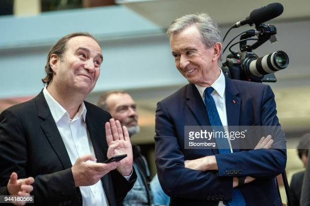Xavier Niel billionaire and deputy chairman of Iliad SA left speaks with Bernard Arnault billionaire and chief executive officer of LVMH Moet...
