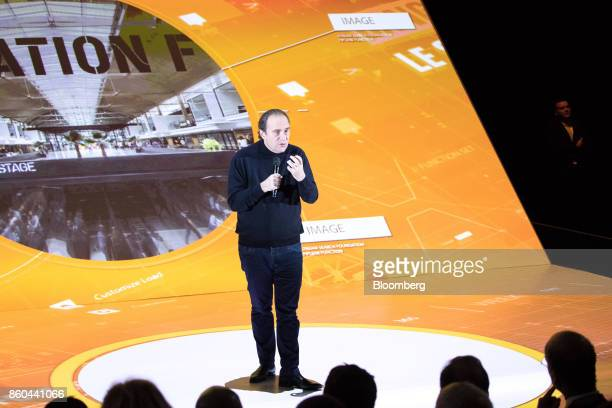 Xavier Niel billionaire and vice chairman of Iliad SA gestures as he speaks during the BPI France forum in Paris France on Thursday Oct 12 2017 Even...