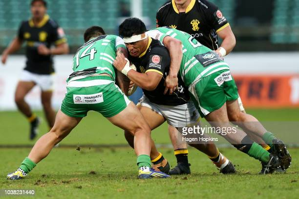 Xavier Numia of Wellington is tackled by Rob Thompson and Sam Stewart of Manawatu during the round six Mitre 10 Cup match between Manawatu and...