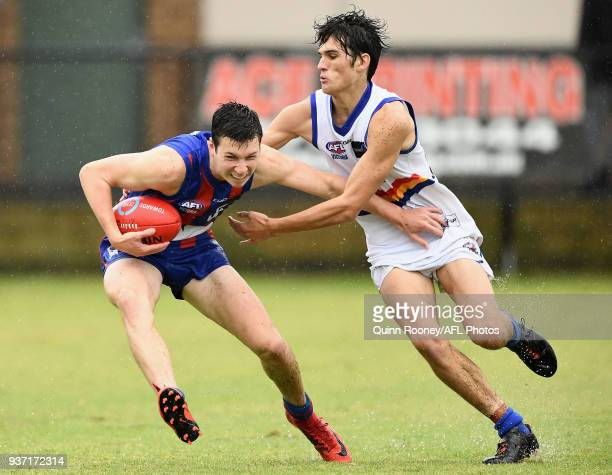 Xavier O'Neill of Oakleigh is tackled during the round one TAC Cup match between Oakleigh and Eastern at Frankston Oval on March 24 2018 in Melbourne...