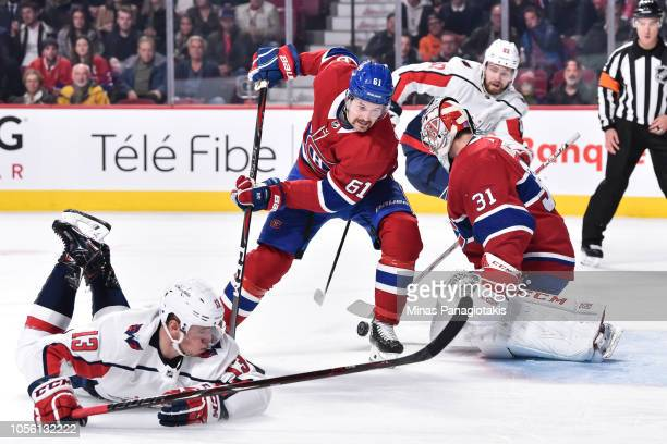 Xavier Ouellet of the Montreal Canadiens tries to pick up a rebound left by goaltender Carey Price near Jakub Vrana of the Washington Capitals during...