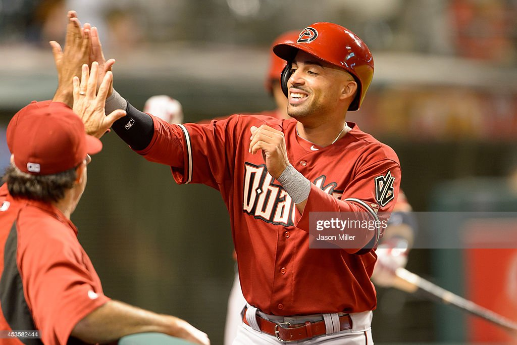 Xavier Paul #14 celebrates after scoring on a hit by Tuffy Gosewisch #9 of the Arizona Diamondbacks during the twelfth inning against the Cleveland Indians at Progressive Field during the second game of a double header on August 13, 2014 in Cleveland, Ohio.