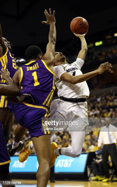 Xavier Pinson of the Missouri Tigers drives to the basket as Ja'vonte Smart of the LSU Tigers defends during the game at Mizzou Arena on January 26...
