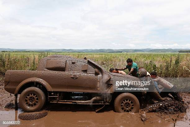 Xavier Pons of Spain and Adrian Ricardo Torlaschi of Argentina in the FORD RANGER for DMAS SOUTH RACING are helped by spectators after getting stuck...
