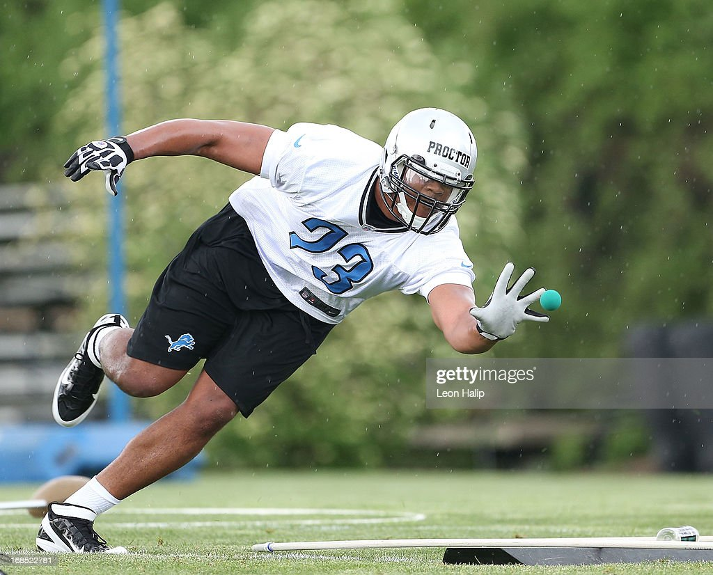 Xavier Proctor #73 of the Detroit Lions goes through the afternoon drills during the first day of Rookie Camp on May 10, 2013 in Allen Park, Michigan.