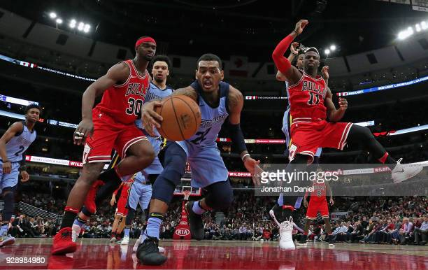 Xavier RathanMayes of the Memphis Grizzlies moves to a loose ball between Noah Vonleh and David Nwaba of the Chicago Bulls at the United Center on...