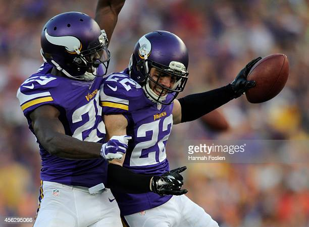 Xavier Rhodes and Harrison Smith of the Minnesota Vikings celebrate an inception by Smith against the Atlanta Falcons during the fourth quarter of...