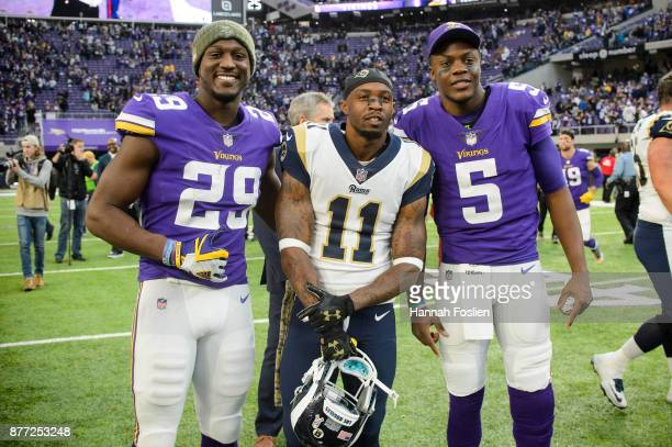 Xavier Rhodes and Teddy Bridgewater of the Minnesota Vikings pose for a photo with Tavon Austin of the Los Angeles Rams after the game on November 19...