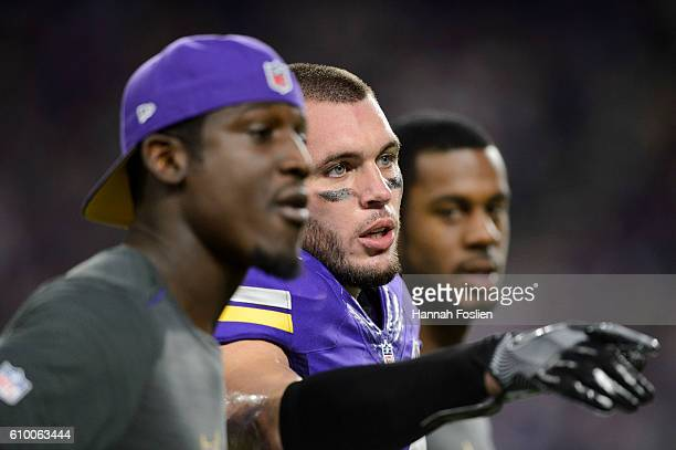 Xavier Rhodes Harrison Smith and Kentrell Brothers of the Minnesota Vikings look on before the game against the Green Bay Packers on September 18...