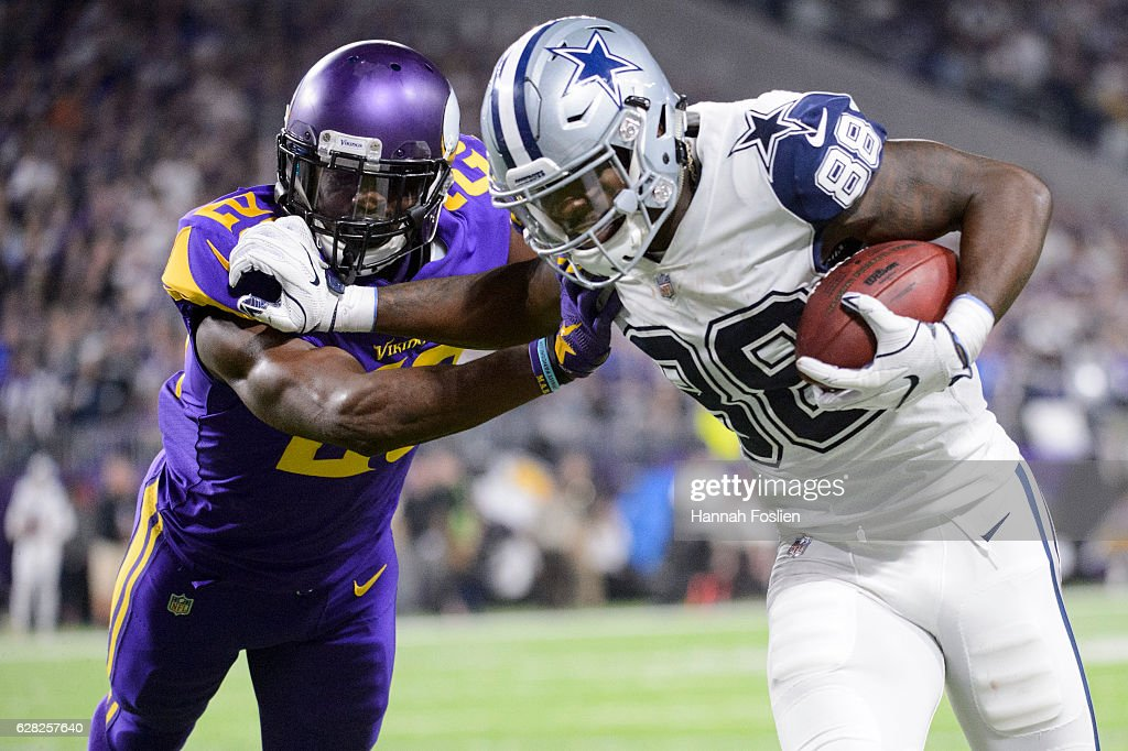 Xavier Rhodes Of The Minnesota Vikings Attempts To Push Dez