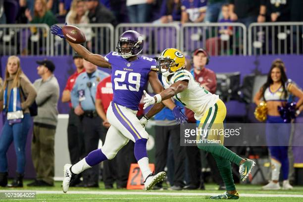 Xavier Rhodes of the Minnesota Vikings breaks up a pass intended for Davante Adams of the Green Bay Packers during the game at US Bank Stadium on...