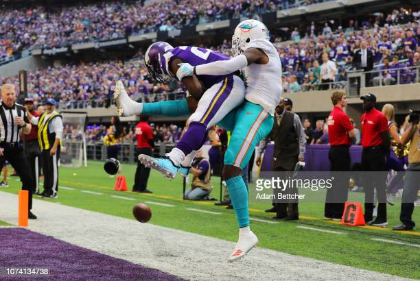 Xavier Rhodes of the Minnesota Vikings breaks up a pass to DeVante Parker of the Miami Dolphins in the second quarter of the game at US Bank Stadium...