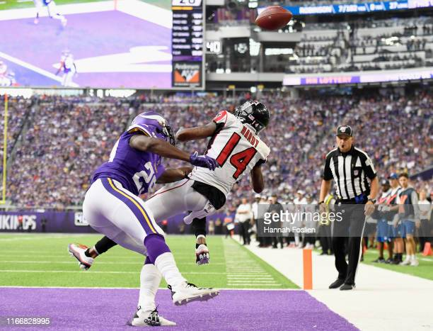 Xavier Rhodes of the Minnesota Vikings breaks up a touchdown pass intended for Justin Hardy of the Atlanta Falcons during the fourth quarter of the...