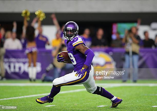 Xavier Rhodes of the Minnesota Vikings carries the ball after intercepting New York Giants quarterback Eli Manning in the third quarter of the game...