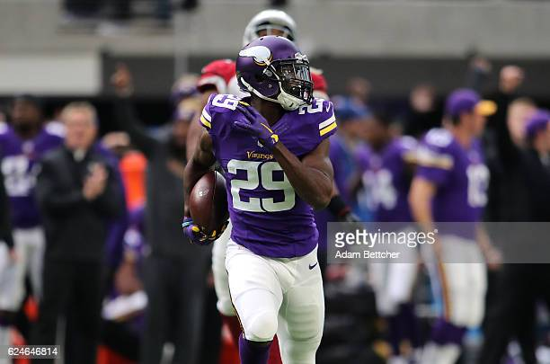 Xavier Rhodes of the Minnesota Vikings carries the ball for a touchdown after intercepting a pass in the second quarter of the game on November 20...