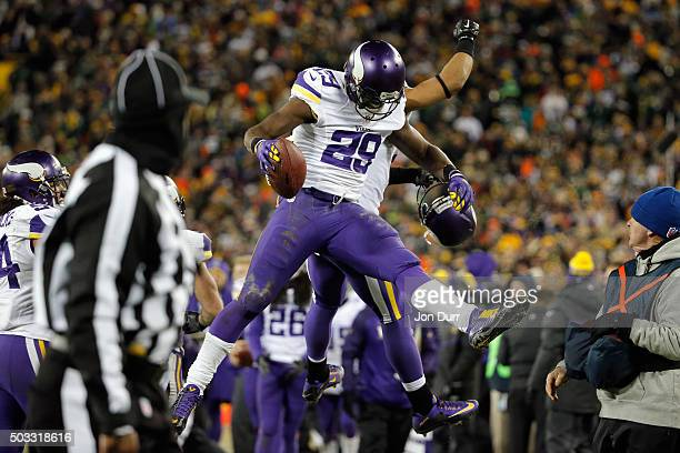 Xavier Rhodes of the Minnesota Vikings celebrates after intercepting a pass in the end zone during the fourth quarter against the Green Bay Packers...