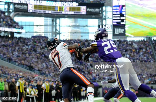 Xavier Rhodes of the Minnesota Vikings knocks the ball away from Dontrelle Inman of the Chicago Bears in the end zone in the fourth quarter of the...