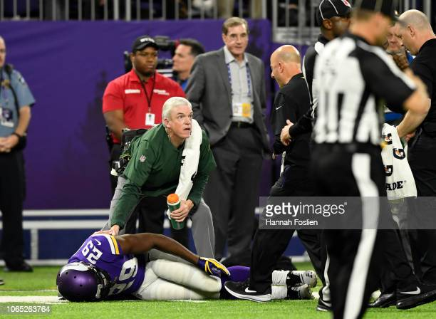 Xavier Rhodes of the Minnesota Vikings lies on the field after sustaining an injury in the fourth quarter of the game against the Green Bay Packers...