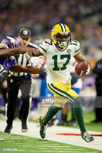 Xavier Rhodes of the Minnesota Vikings pushes Davante Adams of the Green Bay Packers out of bounds during the game at US Bank Stadium on November 25...