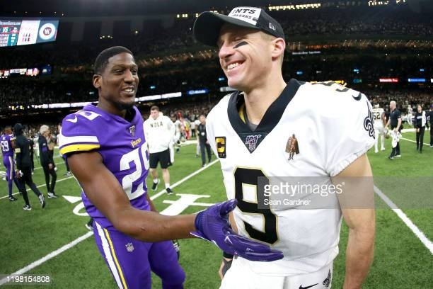 Xavier Rhodes of the Minnesota Vikings reacts with Drew Brees of the New Orleans Saints after the NFC Wild Card Playoff game at Mercedes Benz...