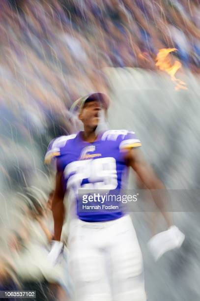 Xavier Rhodes of the Minnesota Vikings runs onto the field during player introductions before the game against the Detroit Lions at US Bank Stadium...