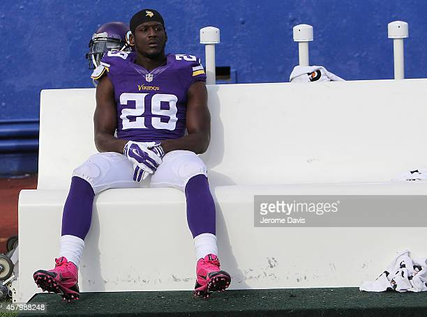 Xavier Rhodes of the Minnesota Vikings sit alone on the bench dejected after losing to the Buffalo Bills at Ralph Wilson Stadium on October 19 2014...