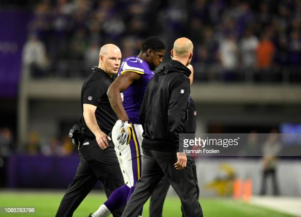 Xavier Rhodes of the Minnesota Vikings walks off the field after sustaining an injury in the fourth quarter of the game against the Green Bay Packers...