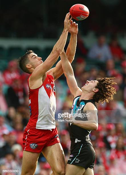 Xavier Richards of the Swans and Darcy Byrne-Jones of the Power contest a mark during the round 20 AFL match between the Sydney Swans and the Port...
