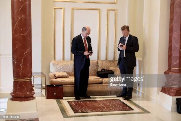 Xavier Rolet chief executive officer of London Stock Exchange Group Plc left looks at his mobile phone as he attends a meeting with UK Prime Minister...