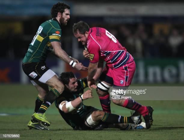 Xavier Rush of Cardiff is tackled by Phil Dowson and Jon Clarke during the Heineken Cup Pool 1 match between Northampton Saints and Cardiff Blues at...