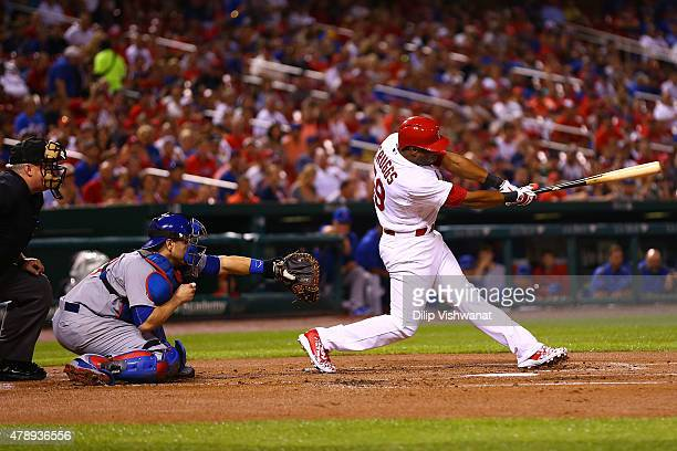 Xavier Scruggs of the St Louis Cardinals hits an RBI single against the Chicago Cubs in the second inning at Busch Stadium on June 28 2015 in St...