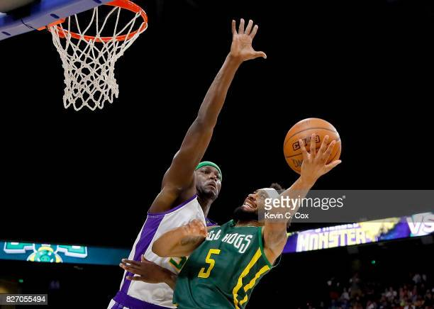 Xavier Silas of the Ball Hogs attempts to shoot around the block of Kwame Brown of the 3 Headed Monsters during week seven of the BIG3 three on three...