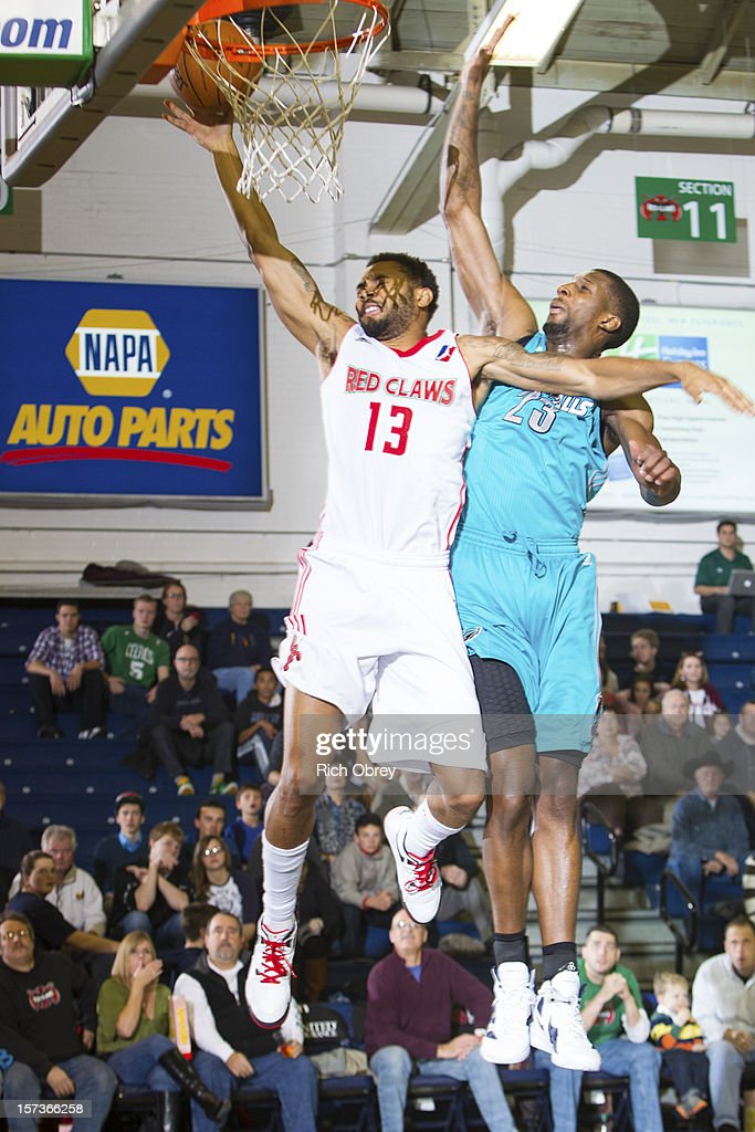 Xavier Silas #13 of the Maine Red Claws is heavily defended by Demetris Nichols #23 of the Sioux Falls Skyforce on December 2, 2012 at the Portland Expo in Portland, Maine.