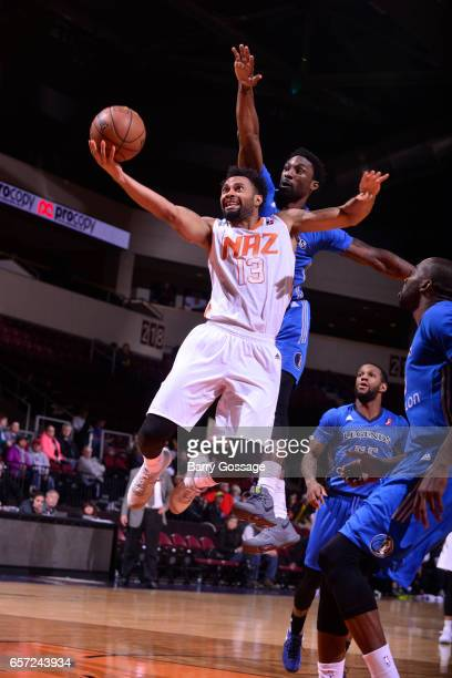 Xavier Silas of the Northern Arizona Suns drives to the basket around Ben Gordon of the Texas Legends on March 23 2017 at Prescott Valley Event...